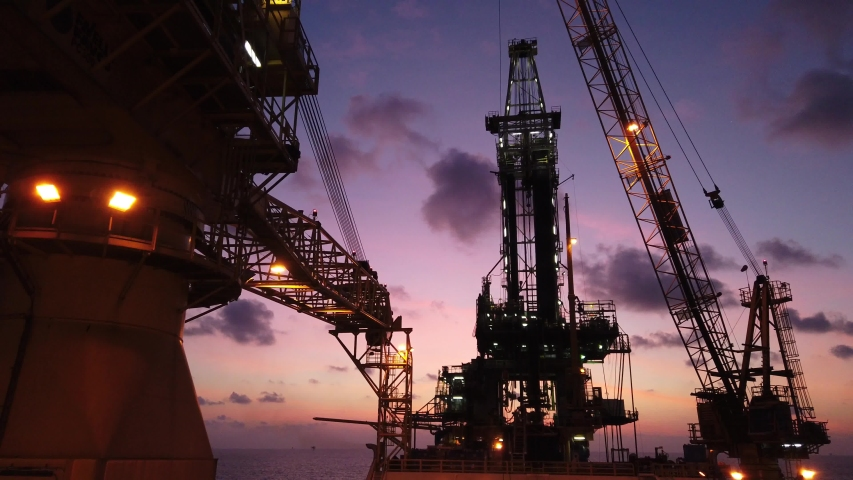 Tender Drilling Oil Rig (Barge Oil Rig) on The Production Platform at Twilight Time