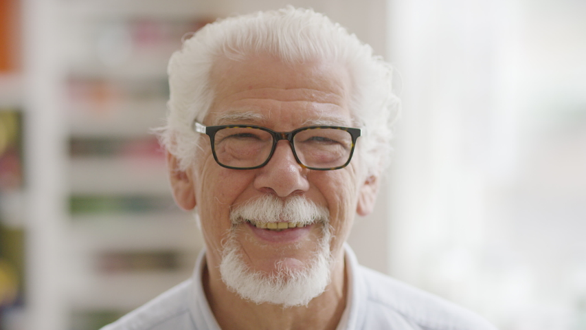 Portrait of handsome senior man looking to camera and smiling  | Shutterstock HD Video #1032397082