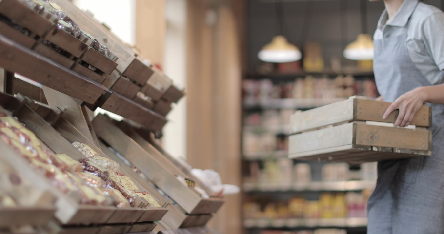 Small business owner of a food market stocking shelves | Shutterstock HD Video #1032408467