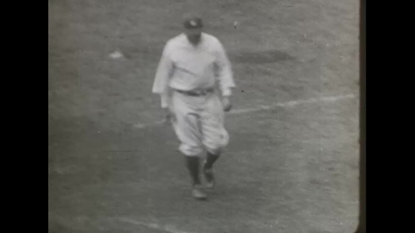 CIRCA 1927 - Babe Ruth waves his hat to spectators during his record-making home run.