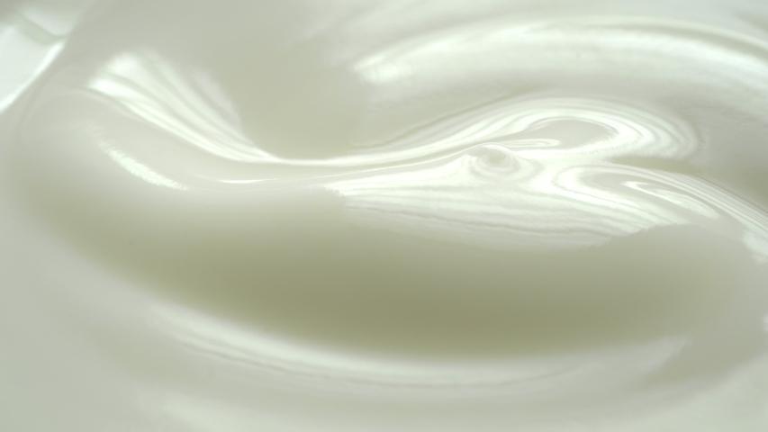 Closeup shot of texture yogurt with rotate.  #1032429065