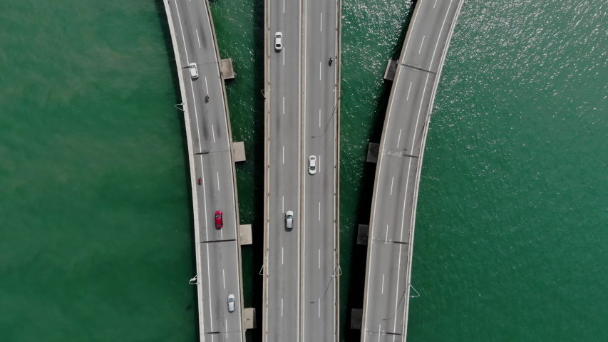 Top down aerial view of the first Penang Bridge. The bridge connects Prai on the mainland side of the state with Gelugor on the island, crossing the Penang Strait.