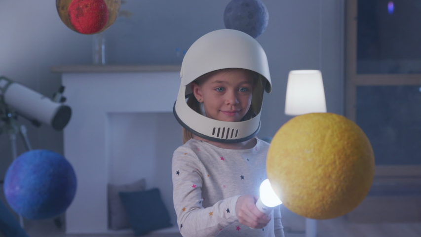 Interstellar Inspiration of Epic Nasa Mission out Earth Globe. Night Dreamy Spaceman Walking Indoors. Baby Lifestyle of Small Playful Person. Cheerful Light of Beautiful Fly to Modern Global World | Shutterstock HD Video #1032439403