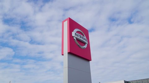 Tallinn Estonia 2019 June 08: A closer look of the Nissan logo on the tower wall of the cars showroom building