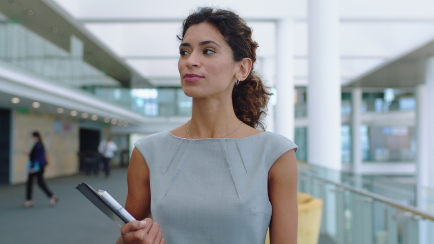 confident business woman walking in airport smiling independent female executive enjoying successful corporate career 4k footage #1032462617