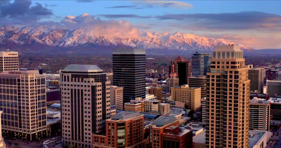 Salt Lake City Utah Skyline at Sunset with Mountains, Aerial Drone