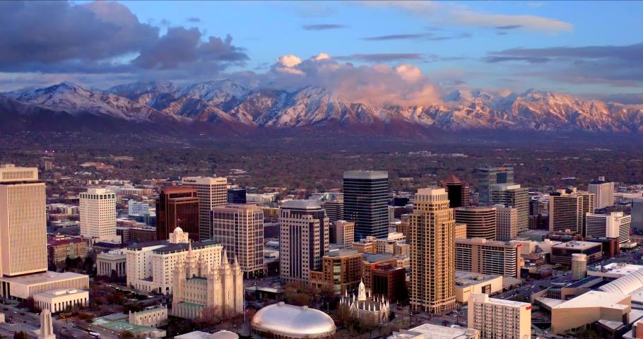 Salt Lake City Utah Skyline at Sunset, Mountains Behind, Aerial Drone