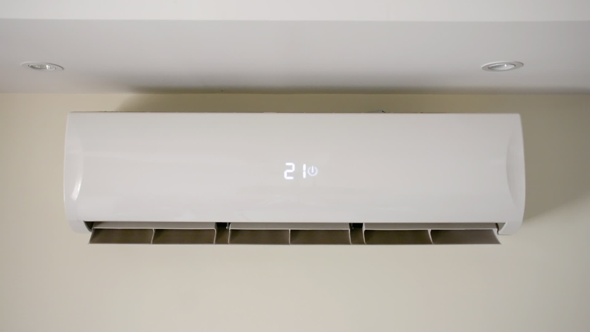 Air conditioner switched on, Start air conditioner on the room wall, change temperature, cooling device, Split system Royalty-Free Stock Footage #1032488807