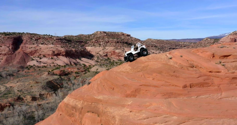 Moab, Utah / USA - April 13, 2019: Jeep at the Top of Canyon, Utah National Park by Aerial Drone