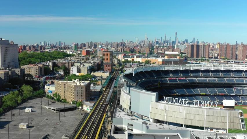BRONX NY, USA - JUNE 21, 2019: Aerial video train passing by Yankee Stadium NY