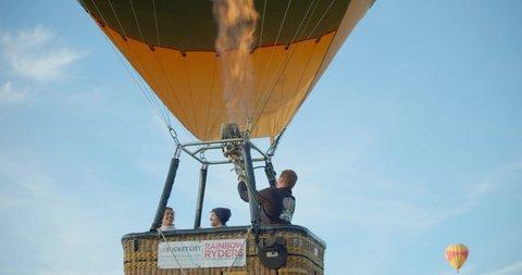 Man Preparing and Launching Hot Air Balloon