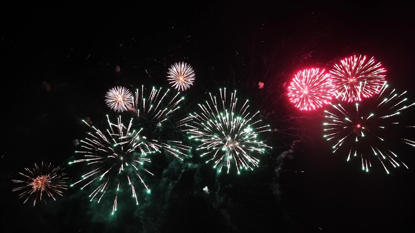 Real Fireworks footage 4k video on Deep Black Background Sky on Futuristic Fireworks festival show before independence day on 4 of July #1032512249