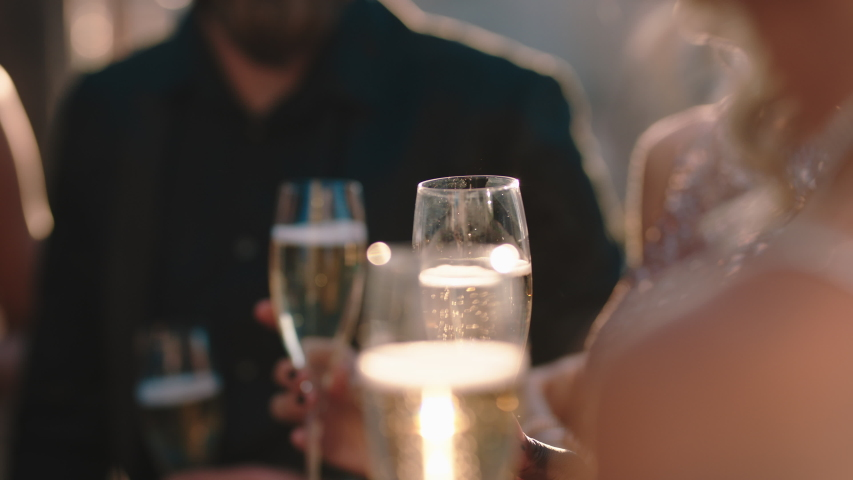 group of friends celebrating glamorous party event drinking champagne wearing stylish fashion chatting at formal social gathering enjoying rooftop celebration 4k Royalty-Free Stock Footage #1032520247