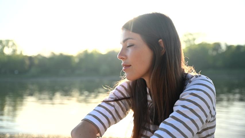 Portrait of a beautiful young woman   Shutterstock HD Video #1032525533