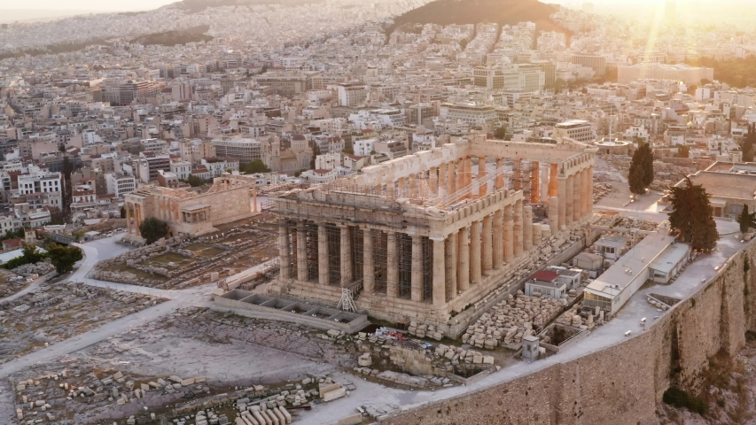 Greece Acropolis city of Athens parthenon, symbol of ancient, aerial view slide from drone on panorama of residential buildings at sunrise summer. Lights sun, lens flare. World Heritage sites. History Royalty-Free Stock Footage #1032528263