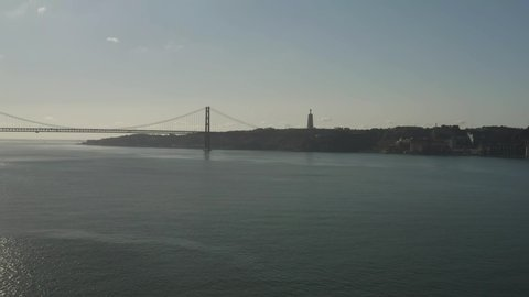 25 April bridge in Lisbon, Portugal, at sunny day, 4k aerial view