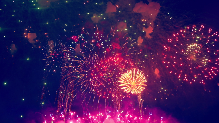 Gleams of colourful fireworks are bursting   Shutterstock HD Video #1032574568
