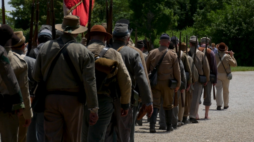 Confederate soldiers march away from the battle field.