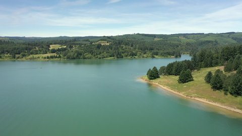 Aerial orbit showing the beaches of Henry Hagg lake in oregon.