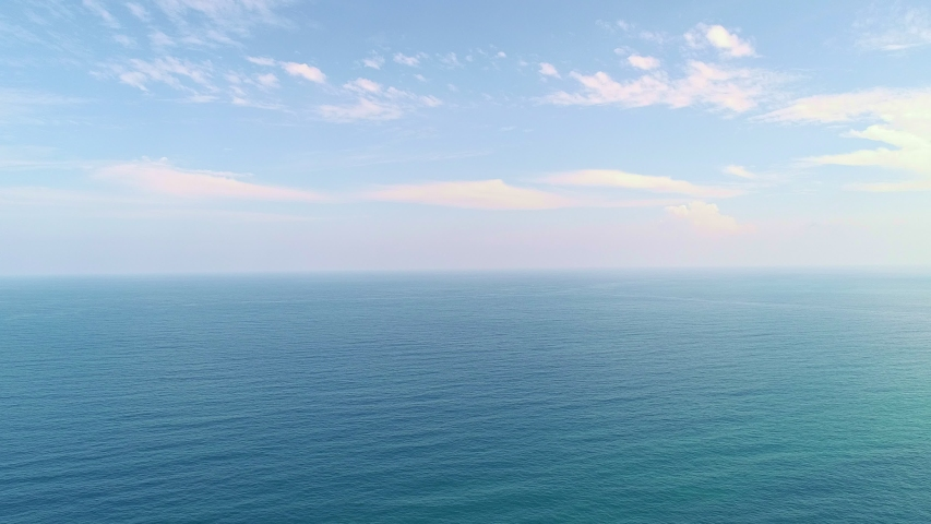 Beautiful Sea in summer season white clouds and blue sky footage from drone aerial view | Shutterstock HD Video #1032602753
