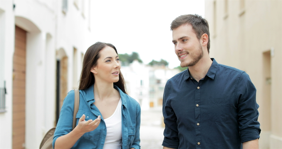 Ill woman coughing and a friend refusing her walking in the street Royalty-Free Stock Footage #1032603293