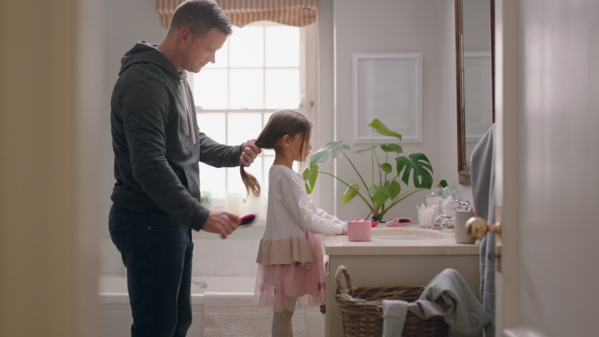 Father brushing daughters hair in bathroom cute little girl getting ready in morning loving father enjoying parenthood caring for child | Shutterstock HD Video #1032680177