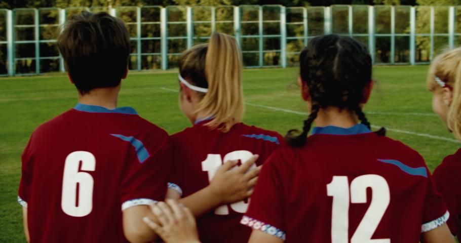 TRACKING Caucasian teenager girl soccer football team celebrating after scoring a goal against opposing team. 4K UHD 60 FPS SLOW MOTION | Shutterstock HD Video #1032691109