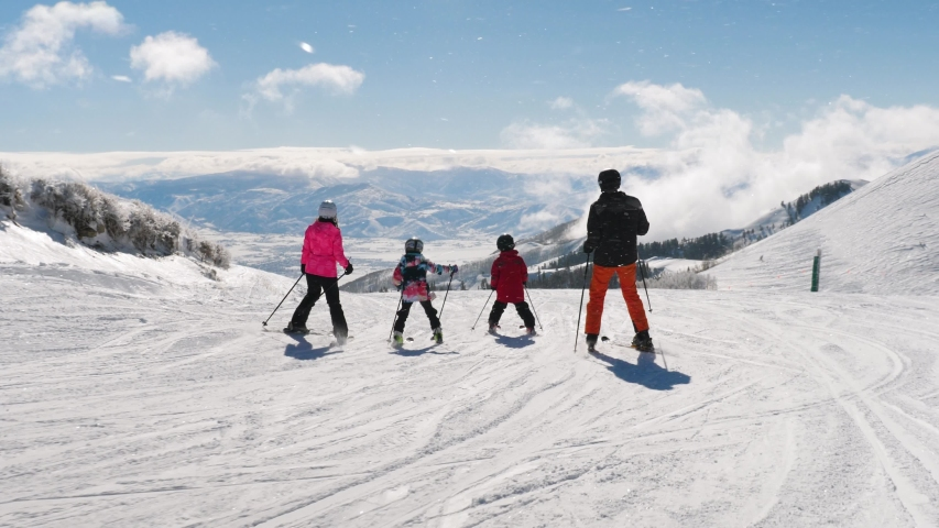 Picturesque View Of Happy Family Riding Ski And Heber Valley Mountains. Excellent beautiful shot of happy family looking to Heber Valley mountains in Utah. | Shutterstock HD Video #1032694277