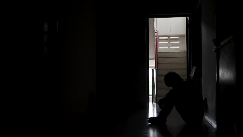 Silhouette Depressed man sitting head in hands on the condo, Sad man, Cry, drama concept | Shutterstock HD Video #1032722189