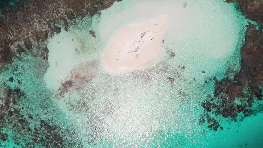 Rotating aeriel birds eye shot over a group of tourists on a tiny tropical island | Shutterstock HD Video #1032723827