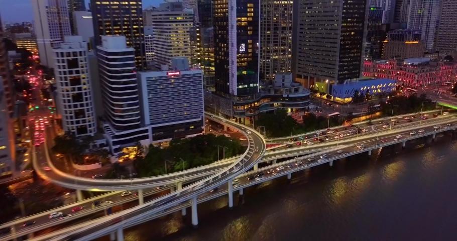 Aerial hyperlapse timelapse of a busy city street highway. at night. Brisbane, Australia.