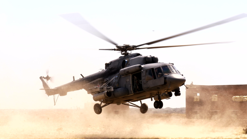 Large cargo army helicopter troops of military soldiers to place of war