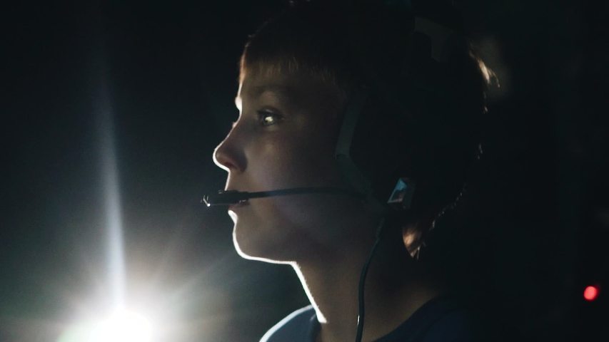 Cool boy playing a video game. He's wearing headsets. Great footage. Beautiful light.   Shutterstock HD Video #1032774470
