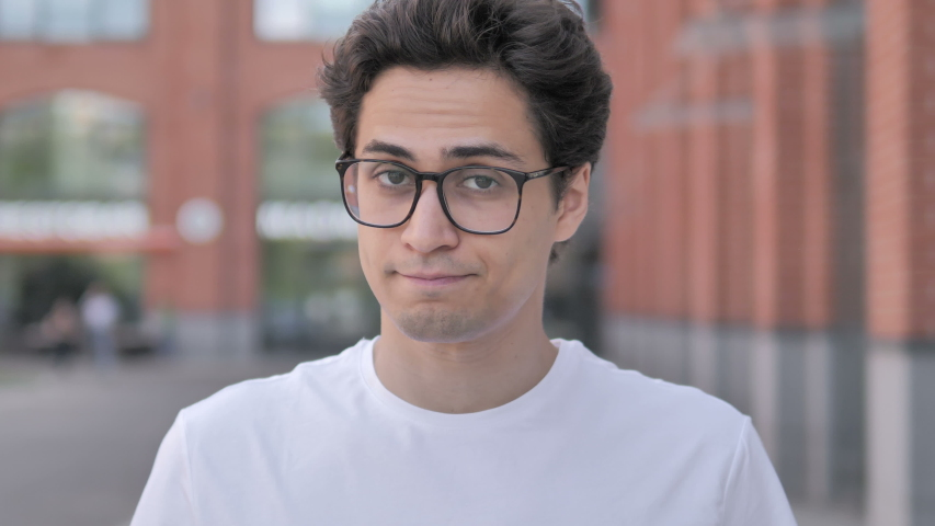 Outdoor Portrait of Young Man Shaking Head To Reject   Shutterstock HD Video #1032775970