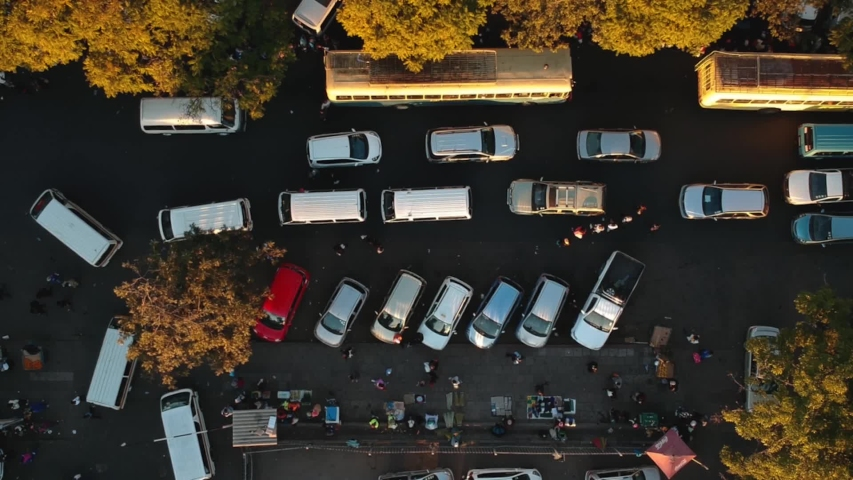 A push in drone shot of city traffic at a busy bus terminus in Bulawayo, Zimbabwe. #1032794453