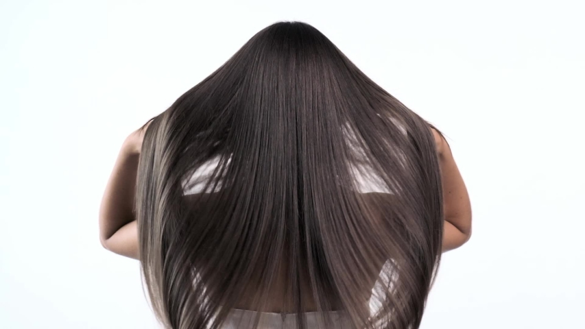 Woman moves long hair. Rear view. Girl shakes long straight hair. Female model is fluttering hair.   Slow motion footage. Rear view. | Shutterstock HD Video #1032804770