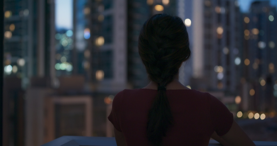 Woman look around the city at night | Shutterstock HD Video #1032810503