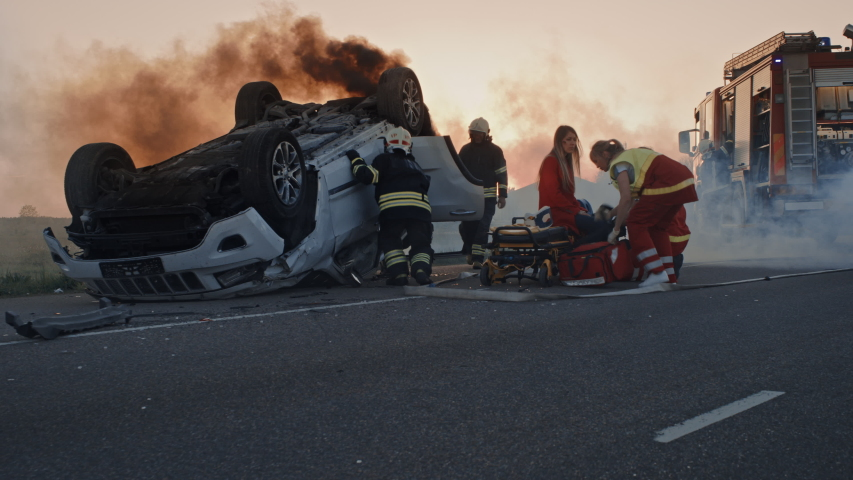 Car Crash Traffic Accident: Paramedics and Firefighters Rescue Injured Trapped Victims. Medics give First Aid to a Female Passenger. Firemen Use Hydraulic Cutters Spreader to Open Vehicle | Shutterstock HD Video #1032836303