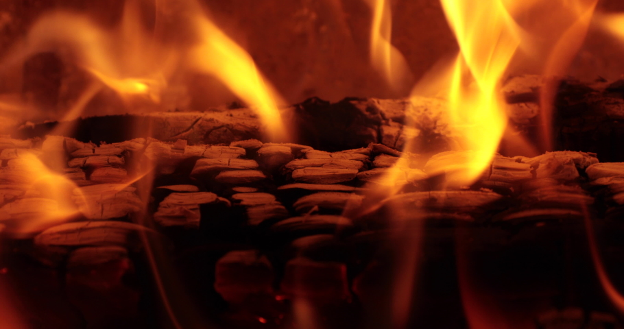 Macro shot of flames around the burned embers of a log in a fireplace | Shutterstock HD Video #1032855227