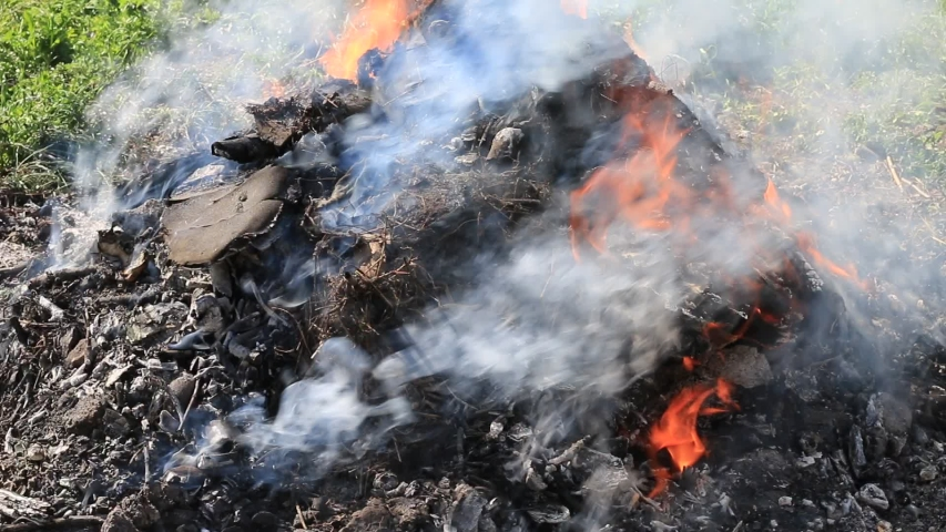Burning and smoking mountain of garbage. Ecology pollution. | Shutterstock HD Video #1032856859