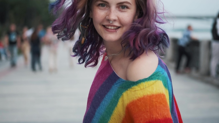 Violet-hair hipster girl emotionally walks and turns around and looks at camera. | Shutterstock HD Video #1032874661