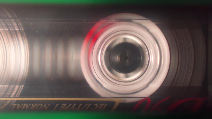 Audiocassette in audiorecorder rewinding fastly closeup view | Shutterstock HD Video #1032879962