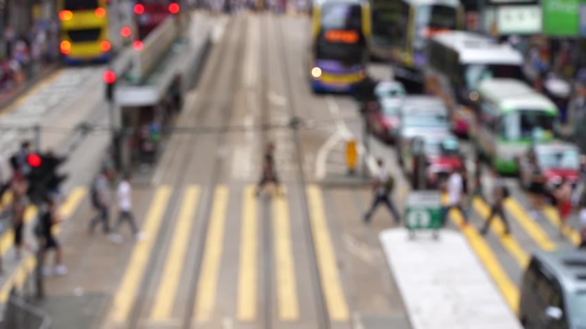 Blurred crowd of people on Hong Kong busy crosswalk; Slow Motion | Shutterstock HD Video #1032880394