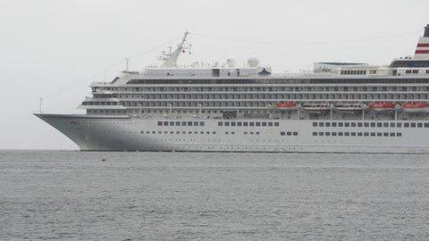 PACIFIC OCEAN, KAMCHATKA PENINSULA, RUSSIA - 8 JULY, 2019: White multideck Japanese Passenger Cruise Liner Asuka II (NYK CRUISES CO., LTD.) sailing in Avacha Bay of Pacific Ocean in Russian Far East.