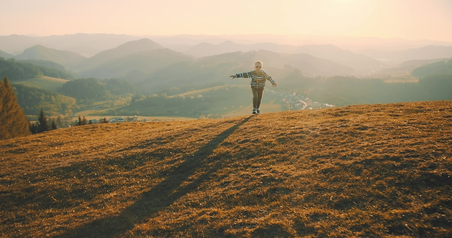 Children playing outside. Happy traveler boy playing with airplane toy on sunny day in park. 4K slow motion video. Child runs on top of mountain at sunset. Journey to the Edge of the Universe   Shutterstock HD Video #1032903950