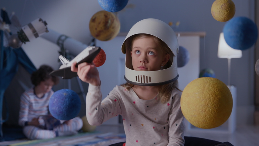 Spaceman Fantasy Flying on Spacecraft. Modern Exploration Plane. Small Pilot in Playful Family Interior. Creative Spacewalk to Cosmos of Preschool Dreamer Person. Astronomy or Night Futuristic Life | Shutterstock HD Video #1032904724