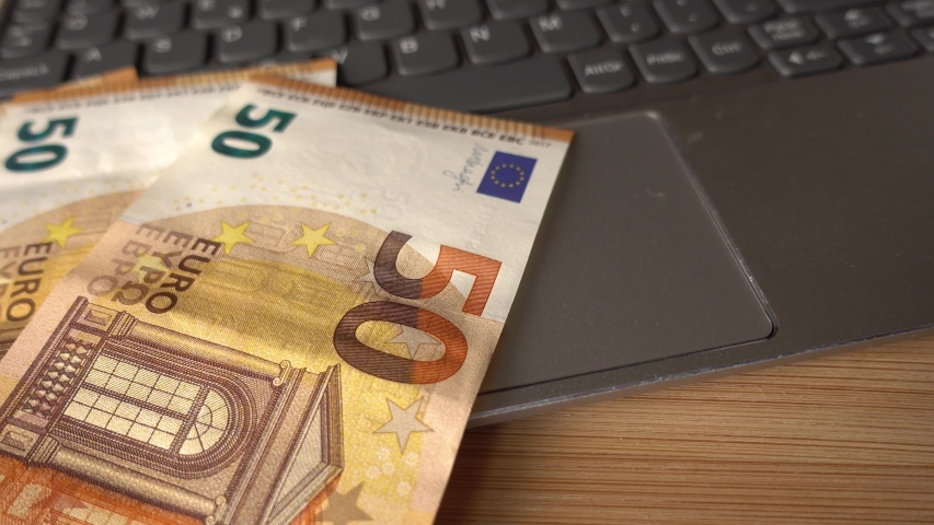 Rotating 50 Euros Paper Money on the Computer Keyboard | Shutterstock HD Video #1032906725
