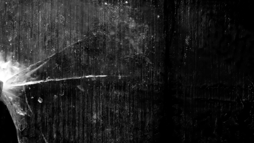 Ice crack in 4k, ready to use in compositions, on black background and isolated, Close-up of thick piece of ice cracking on isolated black background. Great for compositing or motion graphics | Shutterstock HD Video #1032919451