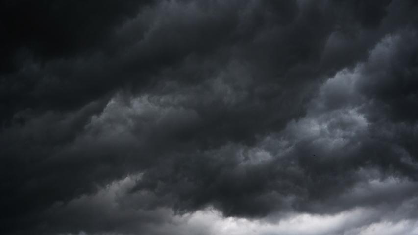 Dark ominous grey storm clouds. Dramatic sky. lighting in dark stormy clouds #1032922913