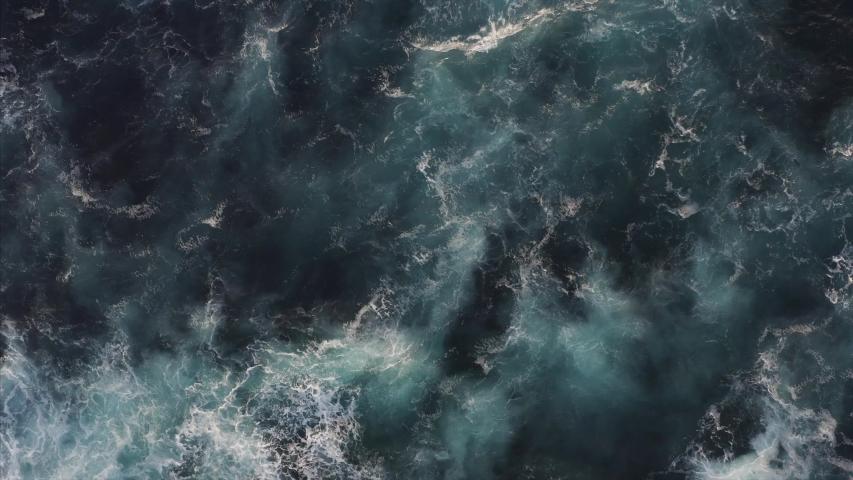 Top aerial slow motion view of surge ocean surface, beautiful foamy ocean waves of azure color | Shutterstock HD Video #1032926369